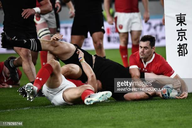TOPSHOT New Zealand's wing Ben Smith scores a try during the Japan 2019 Rugby World Cup bronze final match between New Zealand and Wales at the Tokyo...
