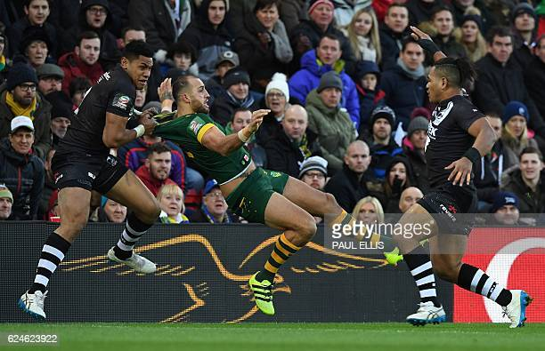 New Zealand's wing David Fusitu'a tackles Australia's wing Blake Ferguson during the rugby league Four Nations Final match between Australia and New...