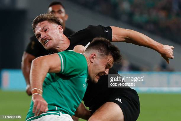 New Zealand's wing George Bridge is tackled by Ireland's wing Jacob Stockdale during the Japan 2019 Rugby World Cup quarter-final match between New...