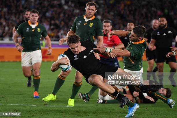 New Zealand's wing George Bridge scores a try during the Japan 2019 Rugby World Cup Pool B match between New Zealand and South Africa at the...
