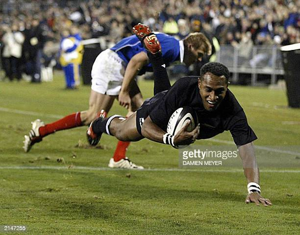 New Zealand's wing Joe Rokococo scores his first try close to France's wing Aurelien Rougerie during the rugby Test match New Zealand/France at Jade...