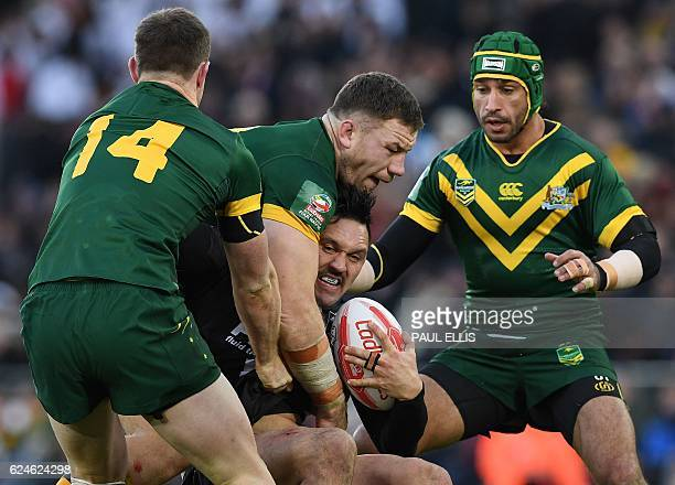 New Zealand's wing Jordan Rapana vies with Australia's Michael Morgan and Australia's standoff Johnathan Thurston during the rugby league Four...