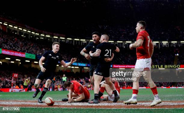 New Zealand's wing Rieko Ioane celebrates scoring a try during the Autumn international rugby union Test match between Wales and New Zealand at the...