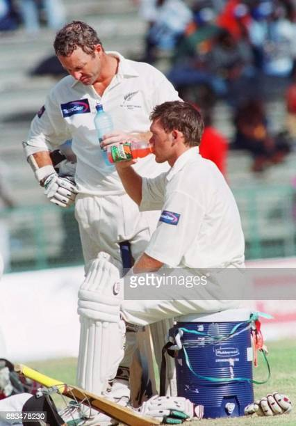 New Zealnd batsmen Mark Richardson and Lou Vincent take a break after their 100 partnership on the 4th day of the 2nd Test at Queen's Park National...