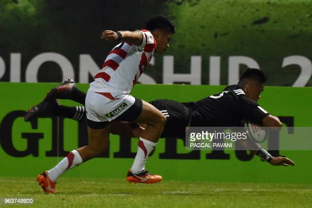 New Zeland winger Bailyn Sullivan scores a try during the World union Rugby U20 Championship match between NewZealand and Japan at the Parc des...
