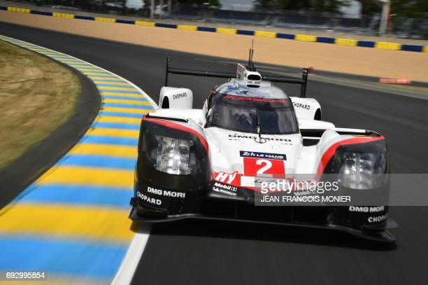 New Zeland's pilot Earl Bamber drives his Porsche 919 Hybrid N°2 during a free practice session of the Le Mans 24 hours endurance race on June 4 2017...
