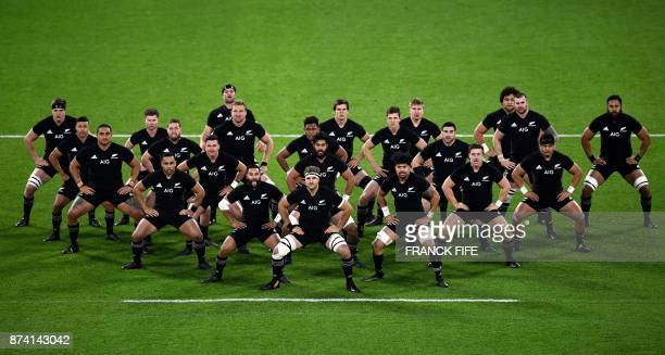 New Zeland's players make the Haka in front of the France's players prior to the international rugby union test match between France and the New...