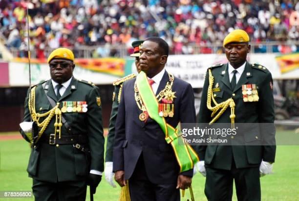 New Zimbabwe President Emmerson Mnangagwa walks after swornin during a ceremony on November 24 2017 in Harare Zimbabwe