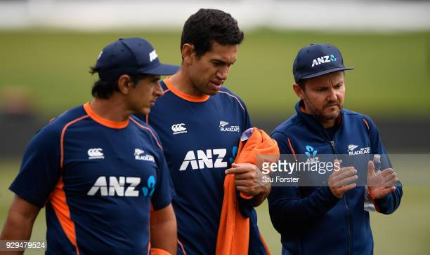 New Zzealand batsman Ross Taylor chats with coach Mike Hesson and physio Tommy Simsek after a fitness test ahead of the 5th and final ODI against the...