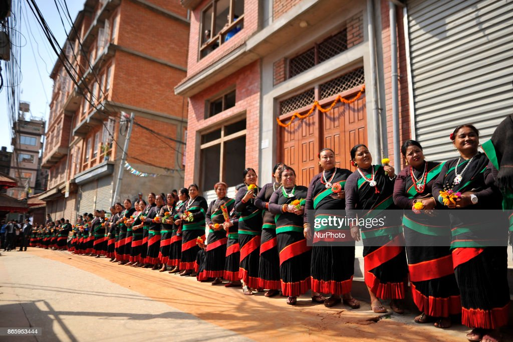 Newari community people in a traditional attire lining by holding flowers to welcome President Bidhya Devi Bhandari during inauguration ceremony of Jyapu Museum on the occasion of 72nd United Nations Day in Chyasal, Lalitpur, Nepal on Tuesday, October 24, 2017.