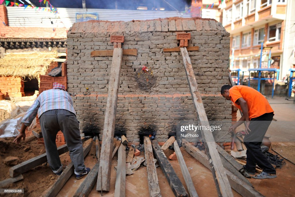 Newari community people making bricks during inauguration ceremony of Jyapu Museum on the occasion of 72nd United Nations Day in Chyasal, Lalitpur, Nepal on Tuesday, October 24, 2017.