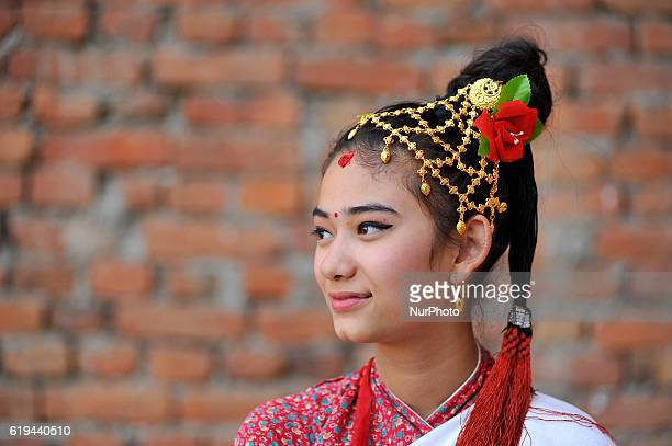 A Newari girl in a traditional attire participate in the parade of Nhu Dan which falls on Tihar or Deepawali and Dewali Festival of Lights at...
