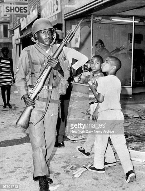Newark children pass National Guardsman during riots