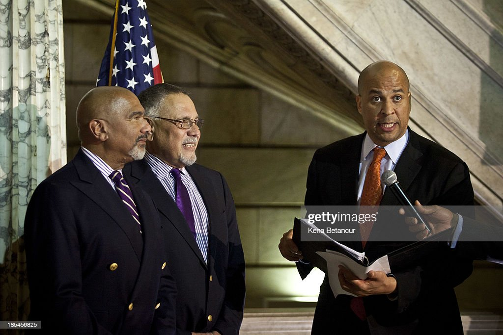 Newark Mayor and newly elected U.S. Senator Cory Booker (L) officiates a wedding ceremony for Joesph Panessidi, 65, (C) and Orville Bell, 65, at City Hall in the early morning hours of October 21, 2013 in Newark, New Jersey. Same-sex couples were allowed to legally wed at 12:01 am on Monday across New Jersey, making the state the 14th to allow same-sex marriages. Following Friday's ruling by the New Jersey Supreme Court, Mayor Cory A. Booker will marry seven gay, lesbian, and straight couples at City Hall in Newark on Monday morning.
