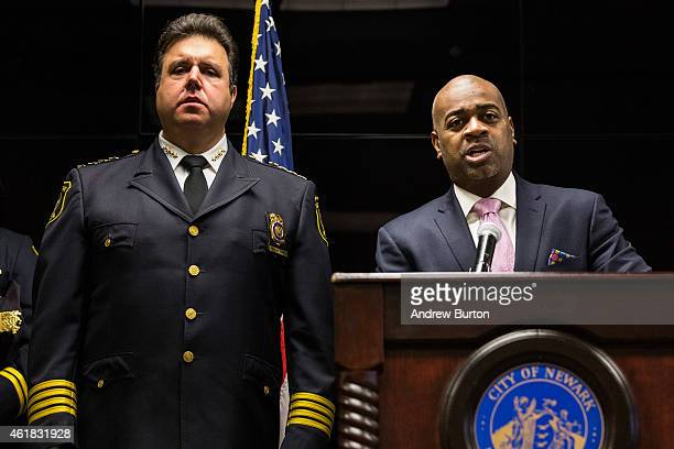 Newark Mayor Ras Baraka speaks as Newark Police Chief Anthony Campos looks o during a press conference regarding the Department of Justice's...
