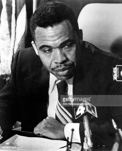 Newark, New Jersey Mayor Kenneth Gibson speaks into several microphones at a press conference, 1977.