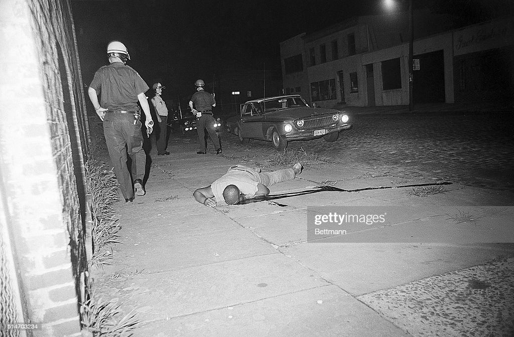 A black who, according to police, had refused to heed an order to stop after being caught looting a burning building in Newark, lies dead on Mulberry Street early July 15th during third straight night of rioting by blacks. 7/15/1967