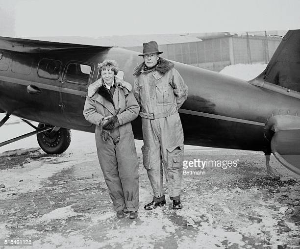 Amelia Earhart and her husband George Palmer Putnam, after arrival at Newark Airport from the West Coast. Their cross-continent flight was made in...