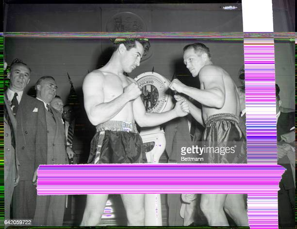 6/9/1948 Newark NJ Rocky Graziano and Tony Zale strike a fighting pose after they weighedin at Newark City Hall for their scheduled Middleweight...