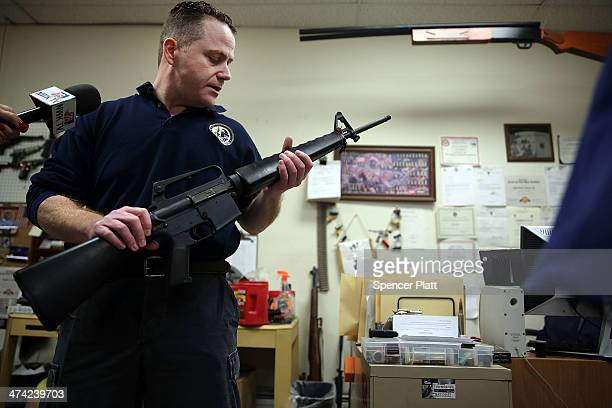 Newark Police Department Ballistics specialist Sergeant Luke Laterza holds a weapon recently returned in a gun buyback on February 22 2014 in Newark...
