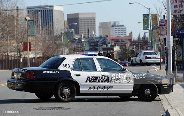 A Newark Police Department car parked in a street during the funeral for singer Whitney Houston February 18 2012 in Newark New Jersey AFP PHOTO/Stan...