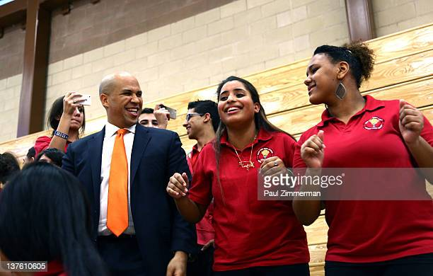 Newark's Mayor Cory Booker dances with students as Fat Joe performs live at Let's Move Newark Our Power at Weequahic High School on January 23 2012...