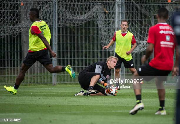 Newbie Jonas Loessl secures the ball during the first public training of the German football league club FSVMainz 05 in Mainz Germany 30 June 2016...