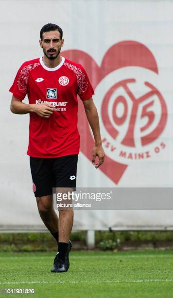 Newbie Jose Rodriguez stands in front of the football club's emblem during the first public training of the German football league club FSVMainz 05...