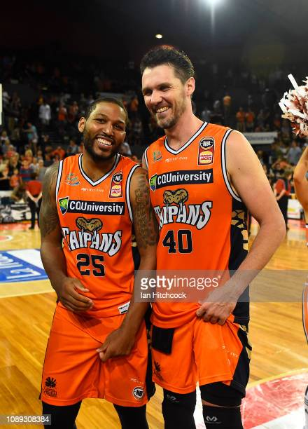 Newbill and Alex Loughton of the Taipans celebrate after winning the round 12 NBL match between the Cairns Taipans and the Brisbane Bullets at Cairns...