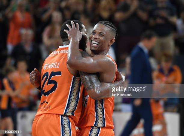Newbill and Scott Machado of the Taipans celebrate after winning the round nine NBL match between the Cairns Taipans and Melbourne United at the...