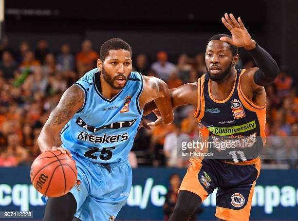 Newbill of the Breakers drives to the basket past Scoochie Smith of the Taipans during the round 15 NBL match between the Cairns Taipans and the New...
