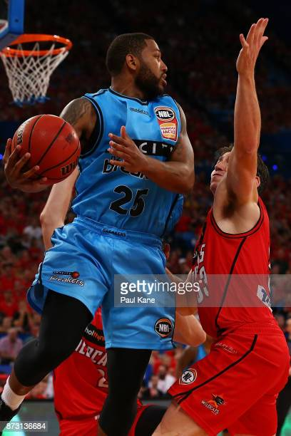 Newbill of the Breakers looks for an outlet pass against Damian Martin of the Wildcats during the round six NBL match between the Perth Wildcats and...