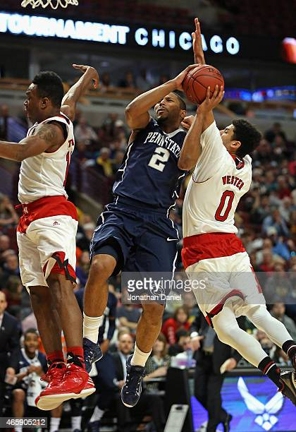 J Newbill of the Penn State Nittany Lions gets off a shot between Tarin Smith and Tai Webster of the Nebraska Cornhuskers during the first round of...