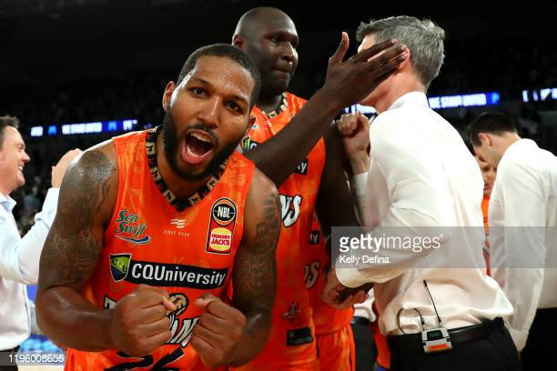 Newbill of the Taipans and Nathan Jawai of the Taipans and Mike Kelly head coach of the Taipans celebrate their win during the round 13 NBL match...