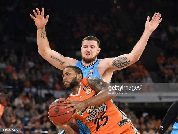Newbill of the Taipans attempts a lay up in front of Thomas Vodanovich of the Breakers during the round 10 NBL match between the Cairns Taipans and...