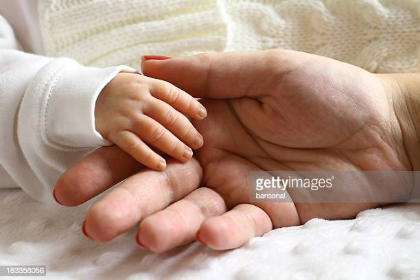 Newborn and mother hands