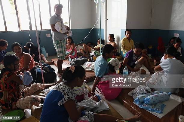 Newborn babies and their mothers share an overcrowded room in the children's and maternity ward at the Eastern Visayas Medical Centre on November 20...