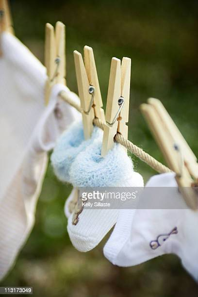 Newborn baby booties hanging on clothesline