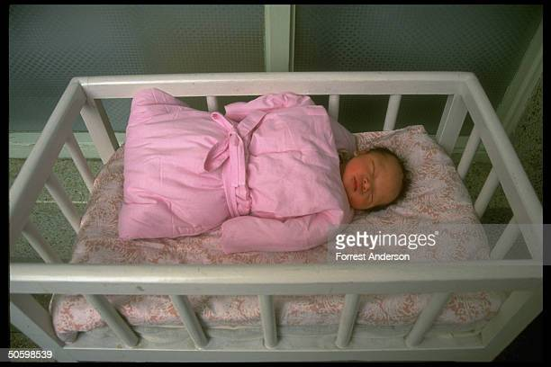 Newborn baby boy asleep in crib at Beijing Maternity Hospital re proposed eugenics law aimed at diseased retarded to improve quality of population
