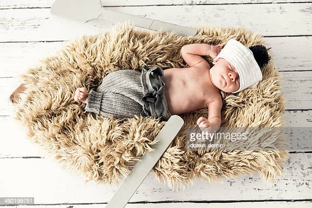 Newborn baby boy is lying on the boat and relaxing