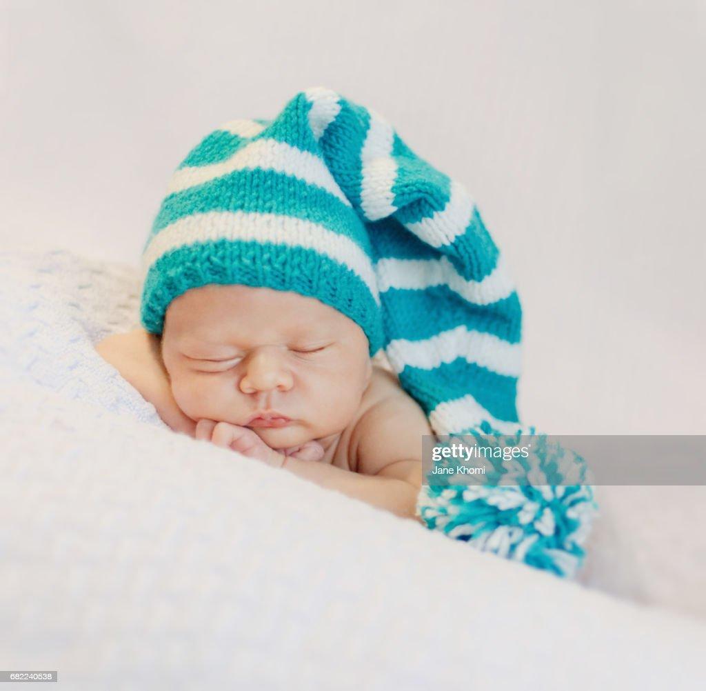 dd070d930c3 ... spain newborn baby boy sleeping peacefully wearing knit hat stock photo  0e35d e0046