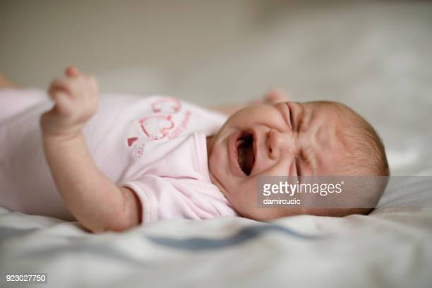 newborn baby girl crying - shouting stock photos and pictures