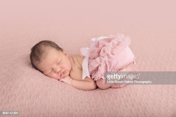 Newborn Baby Girl On Pink