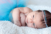 http://www.istockphoto.com/photo/newborn-baby-girl-portrait-of-a-newborn-girl-with-a-fluffy-skirt-and-the-pink-blue-gm670782602-122721939