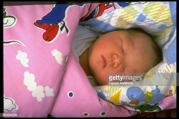 Newborn baby girl sleeping at Beijing Maternity Hospital re proposed eugenics law aimed at diseased retarded to improve quality of population
