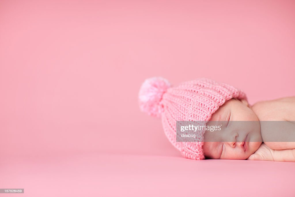 Newborn Baby Girl Sleeping Peacefully on Pink Background : Stock Photo