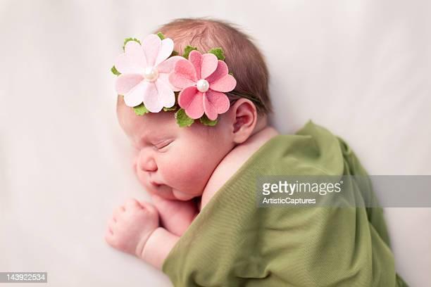 Newborn Baby Girl Swaddled in Soft, Green Blanket