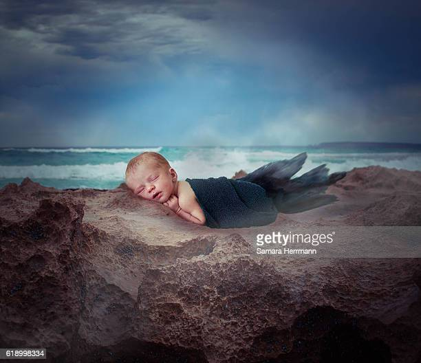 newborn baby in fantasy landscape. - rock baby sleep stock pictures, royalty-free photos & images