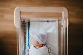 Newborn Baby Sleeping In Hospital Bassinet