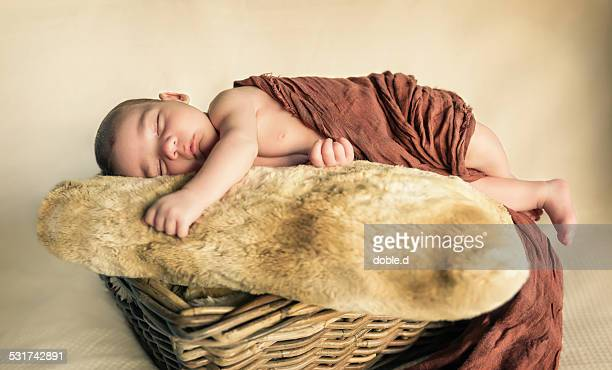 newborn baby sleeping over cushion on a basket - lying in state stock pictures, royalty-free photos & images